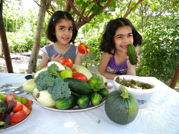 Children enjoying healthy food raised through a rural income generation project