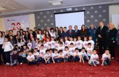 High level officials and the guests were happy to be photoed with child participants of the event