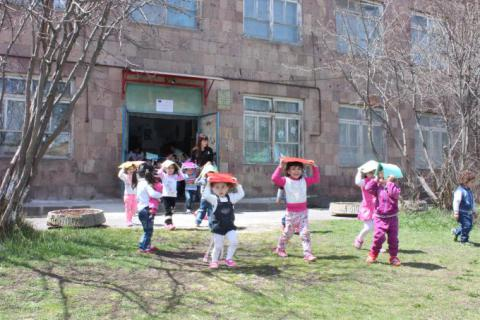 Kindergarten kids evacuating from the building at the earthquake evacuation drill